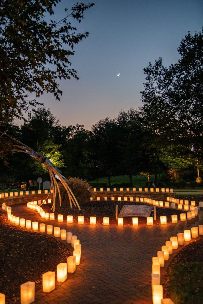 Luminaries around a sculpture garden